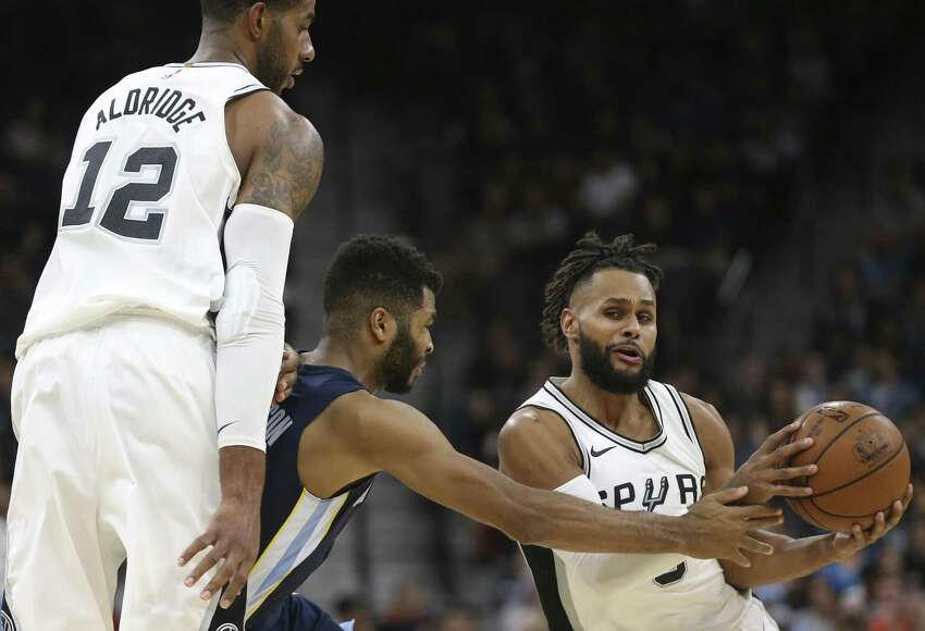 San Antonio Spurs?' LaMarcus Aldridge provides a block as San Antonio Spurs?' Patty Mills tries to get around Memphis Grizzlies?' Andrew Harrison during the first half at the AT&T Center, Wednesday, Nov. 29, 2017.