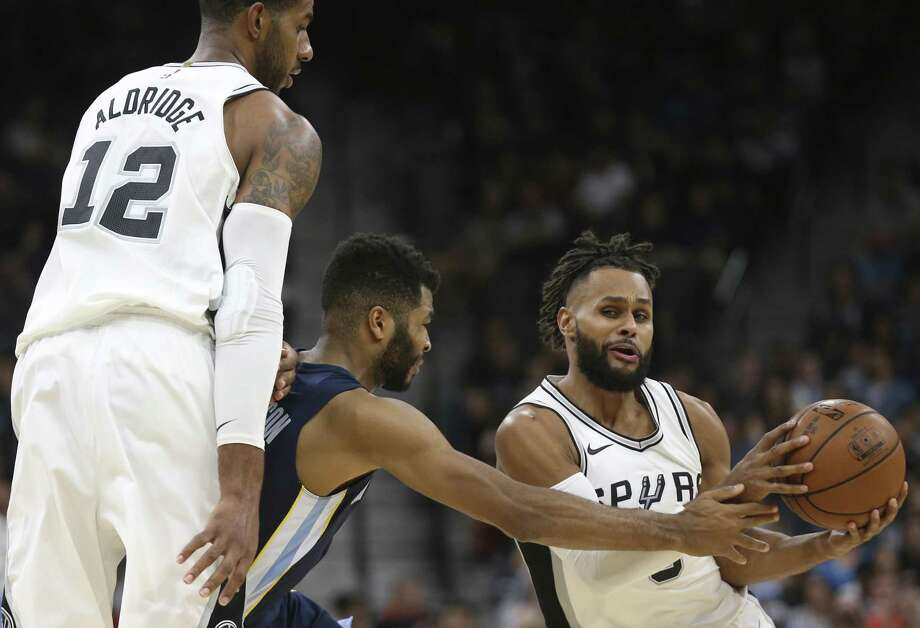 San Antonio Spurs' LaMarcus Aldridge provides a block as San Antonio Spurs' Patty Mills tries to get around Memphis Grizzlies' Andrew Harrison during the first half at the AT&T Center, Wednesday, Nov. 29, 2017. Photo: JERRY LARA / San Antonio Express-News / © 2017 San Antonio Express-News