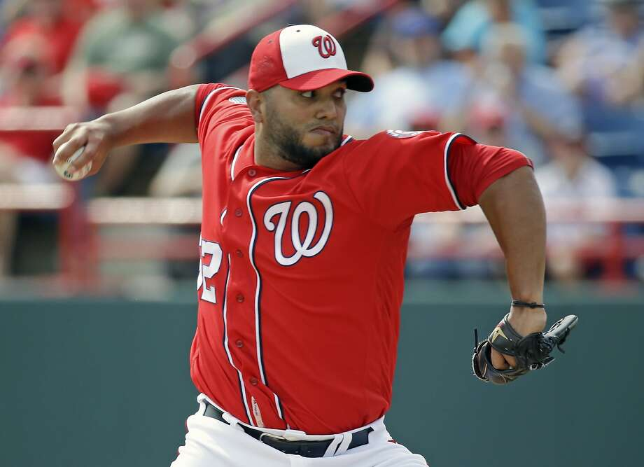 Washington Nationals' Yusmeiro Petit pitches in the third inning of a spring training baseball game against the Washington Nationals, Thursday, March 3, 2016, in Viera, Fla. (AP Photo/John Raoux) Photo: John Raoux, AP