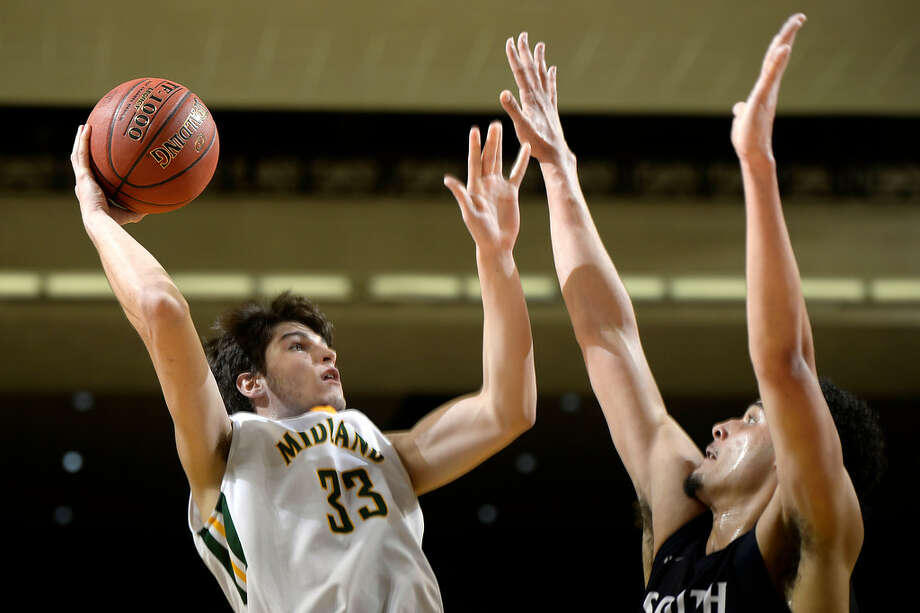Midland College's Kayo Gonclaves (33) rebounds against South Plains College's Isaiah Maurice (10) on Nov. 29, 2017, at Chaparral Center. James Durbin/Reporter-Telegram