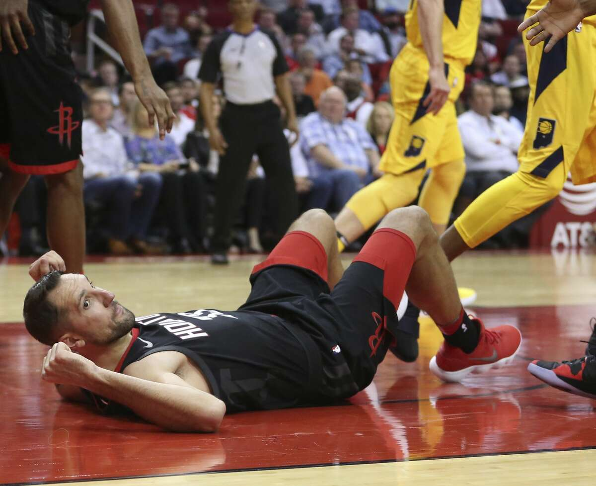 Houston Rockets forward Ryan Anderson (33) falls onto the floor after being fouled by Indiana Pacers during the fourth quarter of a NBA game at Toyota Center on Wednesday, Nov. 29, 2017, in Houston. The Houston Rockets defeated the Indiana Pacers 118-97. ( Yi-Chin Lee / Houston Chronicle )