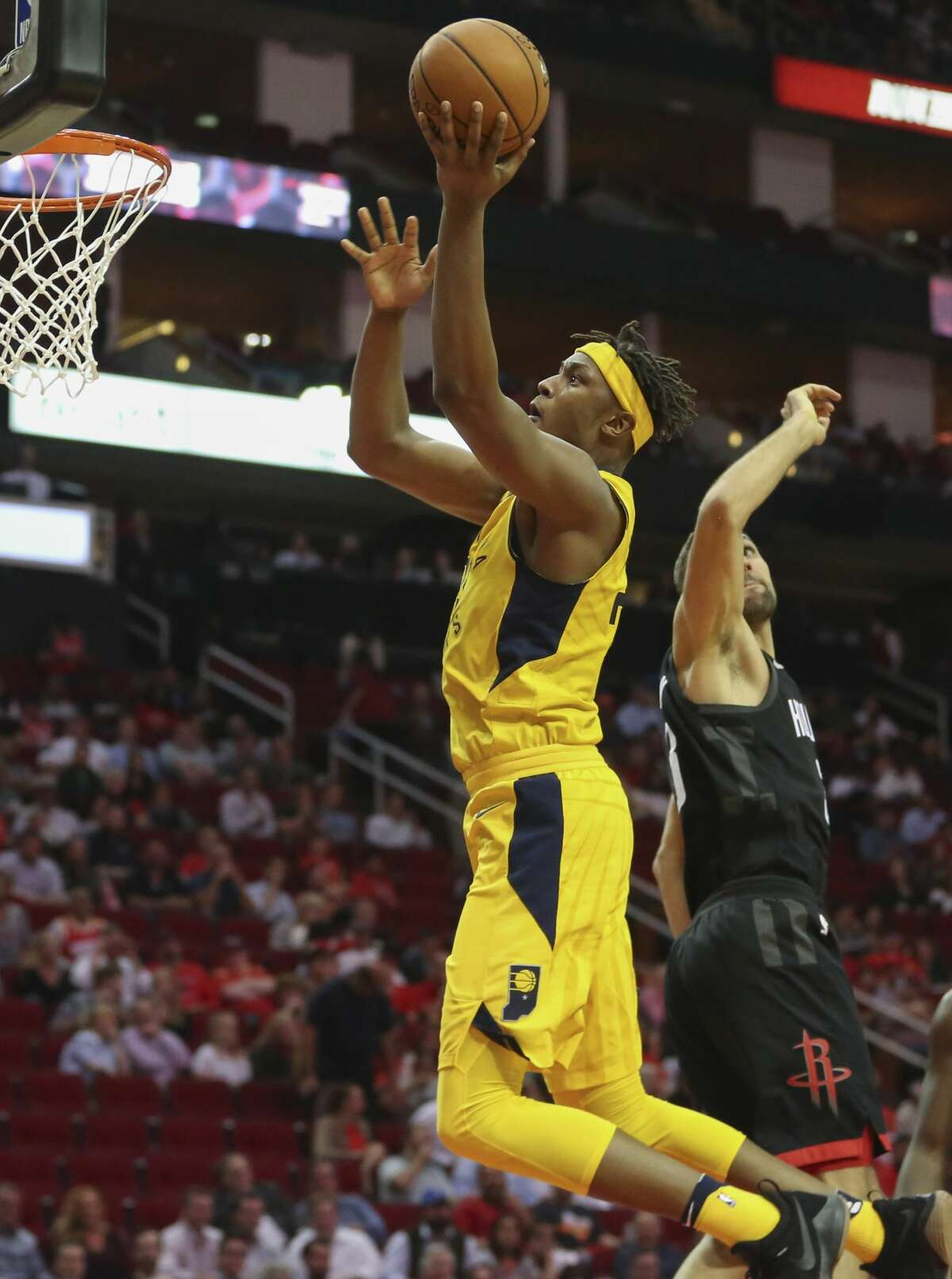 Indiana Pacers center Myles Turner (33) passes Houston Rockets forward Ryan Anderson (33) to score a basket during the fourth quarter of a NBA game at Toyota Center on Wednesday, Nov. 29, 2017, in Houston. The Houston Rockets defeated the Indiana Pacers 118-97. ( Yi-Chin Lee / Houston Chronicle )