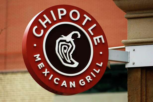 FILE - In this Jan. 12, 2017, file photo, a Chipotle restaurant sign hangs in Pittsburgh. Chipotle says it is looking for a new CEO. Its founder, Steve Ells, who currently serves as CEO and chairman, will become executive chairman once someone new is in place at the top post. (AP Photo/Gene J. Puskar, File) ORG XMIT: NYAG203