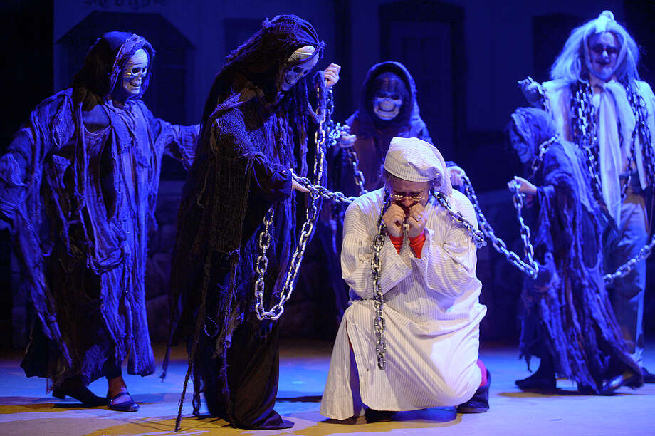 "Chad Peterson stars in the title role of Ebenezer Scrooge during a dress rehearsal for the Beaumont Community Players' upcoming performance of ""Scrooge."" The musical take on Dicken's iconic holiday tale ""A Christmas Carol,"" runs Dec. 1, 2, 8, 9, 14, 15, and 16 at the Betty Greenberg Center for Performing Arts. For additional information on show times and tickets, call 409-833-4664 or visit their website at www.beaumontcommunityplayers.com Photo taken Wednesday, November 29, 2017 Kim Brent/The Enterprise Photo: Kim Brent / BEN"