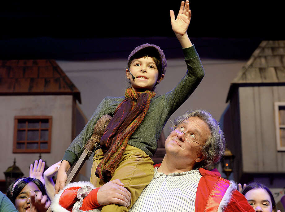 "Scrooge played by Chad Peterson and Tiny Tim portrayed by Savannah Winkler run through the finale during a dress rehearsal for the Beaumont Community Players' upcoming performance of ""Scrooge."" The musical take on Dicken's iconic holiday tale ""A Christmas Carol,"" runs Dec. 1, 2, 8, 9, 14, 15, and 16 at the Betty Greenberg Center for Performing Arts. For additional information on show times and tickets, call 409-833-4664 or visit their website at www.beaumontcommunityplayers.com Photo taken Wednesday, November 29, 2017 Kim Brent/The Enterprise Photo: Kim Brent / BEN"