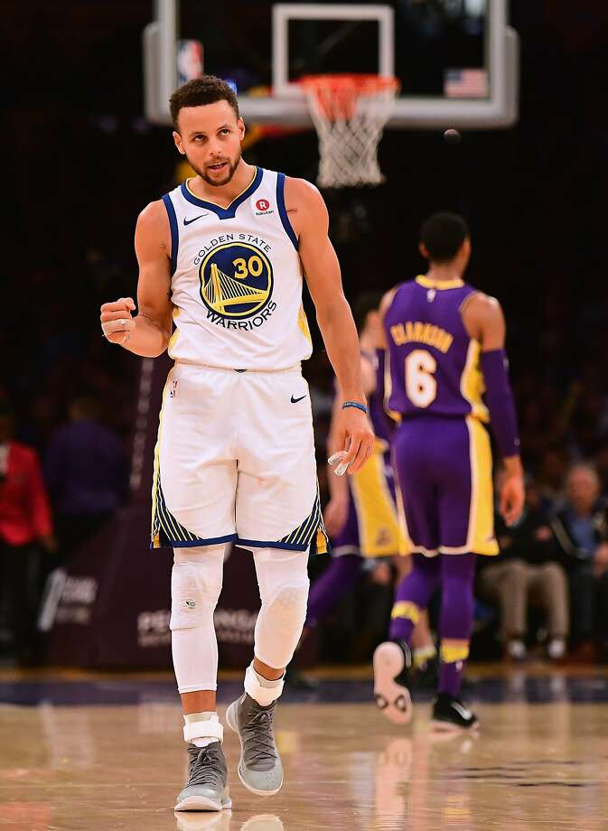 LOS ANGELES, CA - NOVEMBER 29:  Stephen Curry #30 of the Golden State Warriors celebrates his assist leading to a Klay Thompson #11 three pointer during a 127-123 win over the Los Angeles Lakers in overtime at Staples Center on November 29, 2017 in Los Angeles, California.  (Photo by Harry How/Getty Images) Photo: Harry How, Getty Images
