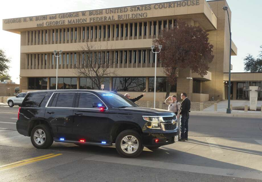 U.S. Marshals block the road in front of the federal courthouse 11/30/17 morning after a bomb threat was called in. Tim Fischer/Reporter-Telegram Photo: Tim Fischer/Midland Reporter-Telegram
