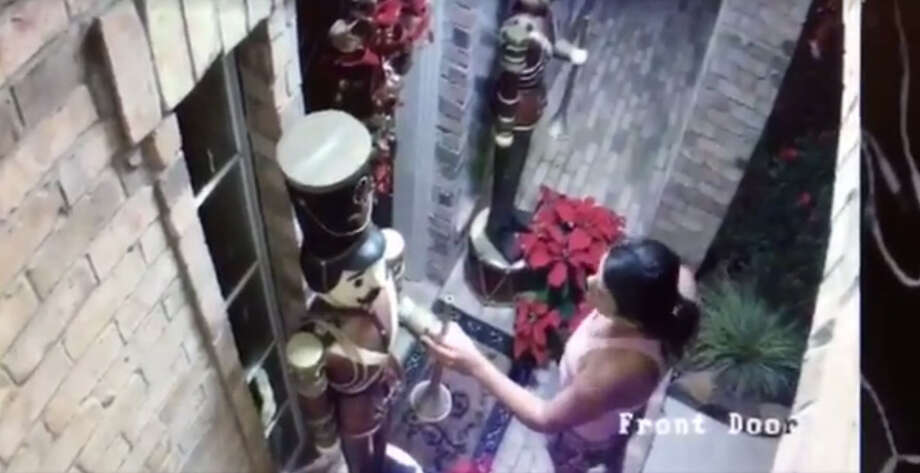 A woman was caught on video Nov. 28 picking up and stealing two giant nutcracker statues from the front of a home in Pasadena. Photo: Ginger Shepherd/Facebook