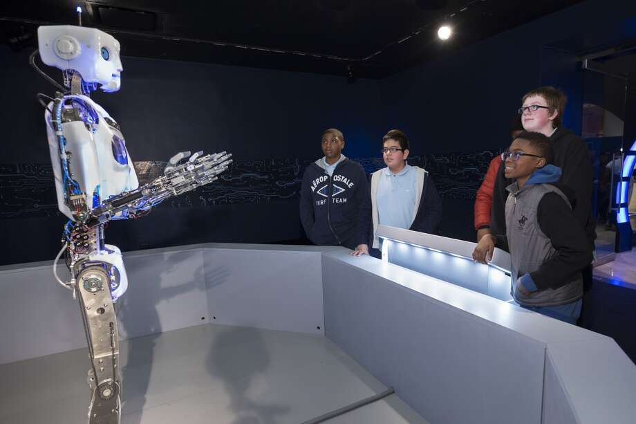 RoboThespian, a humanoid robot that can speak and move in customized ways, greets guests at the entrance. Photo: For The Edge