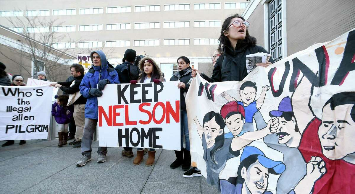 Supporters and family protest outside of Immigration Court in Hartford on behalf of Nelson PInos who has taken sanctuary in the basement of First and Summerfield United Methodist Church in New Haven to avoid deportation on November 30, 2017.