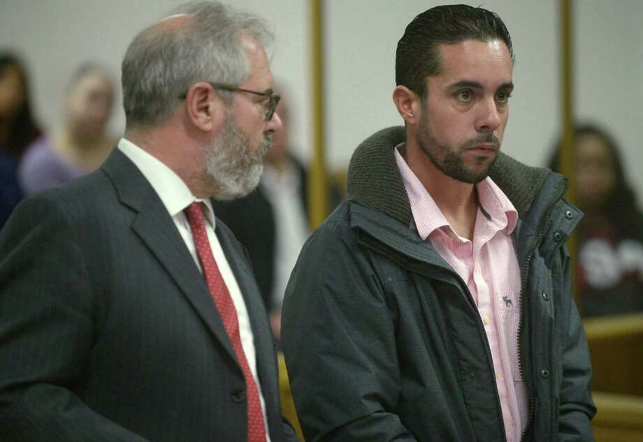Attorney Christian Bujdud accopnaies Daniel Moran, 33, of Norwalk, as he is arraigned on conspiracy to commit illegal taking of a black bear Thursday, November 30, 2017, at Norwalk Superior Court in Norwalk, Conn. Antonio Lio, 28, of Wilton, was also arraigned Thursday on two counts of illegal taking of a black bear and fourth-degree negligent hunting and The DEEP's Environmental Conservation Police arrested the two individuals on Saturday, September 16, 2017, following the killing of the bear. Photo: Erik Trautmann, Hearst Connecticut Media / Norwalk Hour