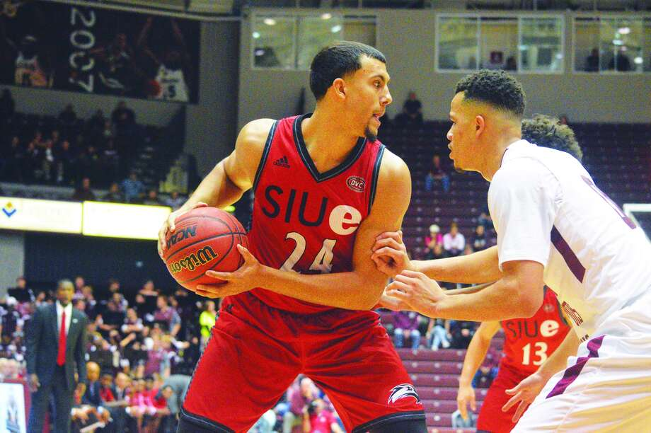 SIUE forward Jalen Henry shields the ball away.
