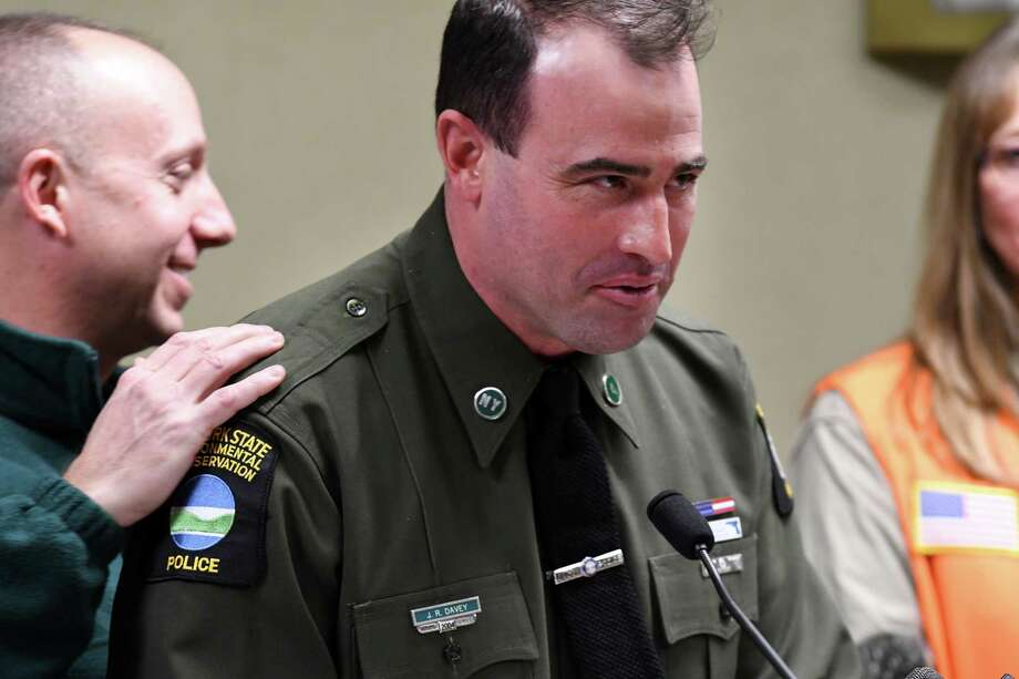 New York State Department of Environmental Conservation Commissioner Basil Seggos, left, introduces DEC Officer James Davey, right, who recently returned to work after being accidentally shot by a hunter last year in Columbia County, on Thursday, Nov. 30, 2017, during a press conference to address hunter safety at DEC headquarters in Albany, N.Y. (Will Waldron/Times Union) Photo: Will Waldron, Albany Times Union / 20042269A