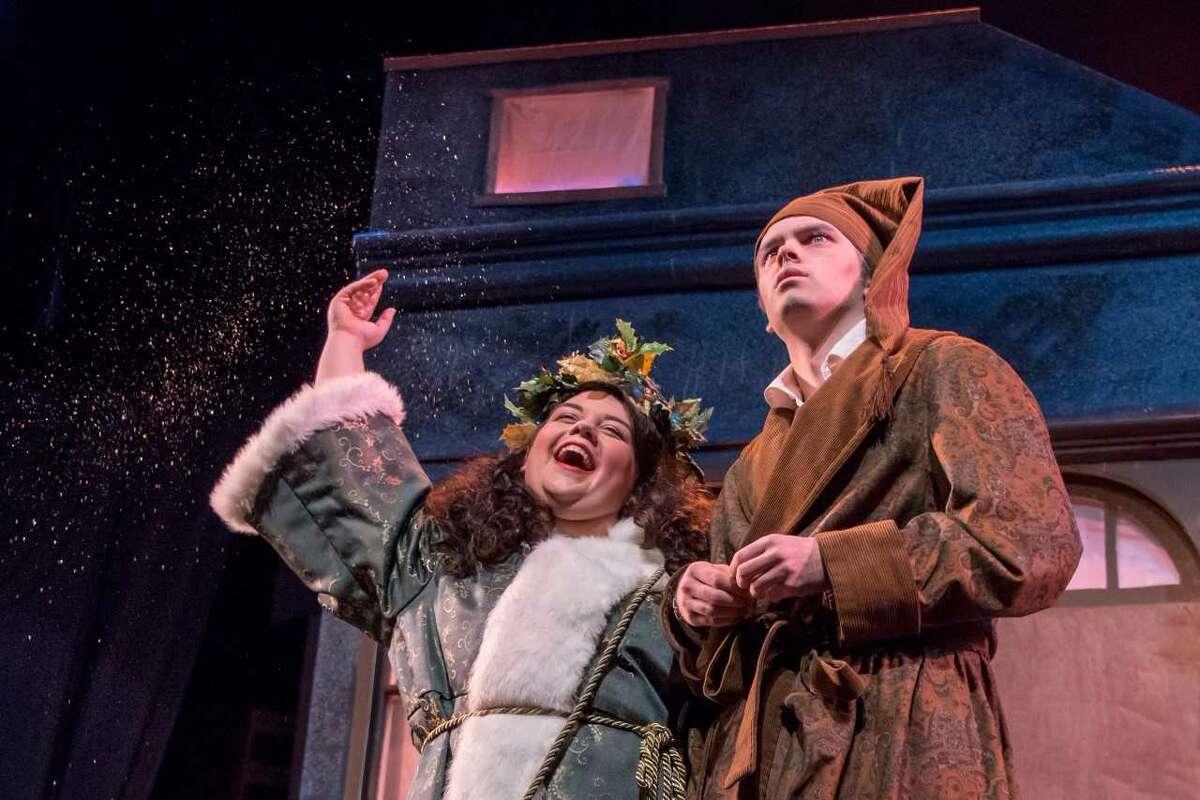 "KD McTeigue as Christmas Present: and Lucas Phayre-Gonzalez as Scrooge in ""A Christmas Carol"" Photo credit: Tamara Hansen"