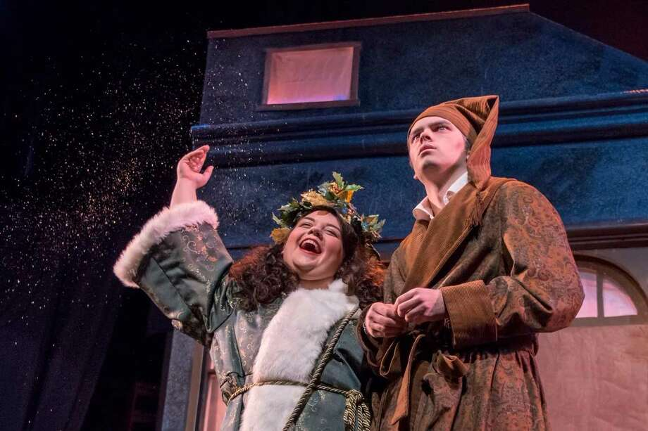 kd mcteigue as christmas present and lucas phayre gonzalez as scrooge in a - Original Christmas Carol