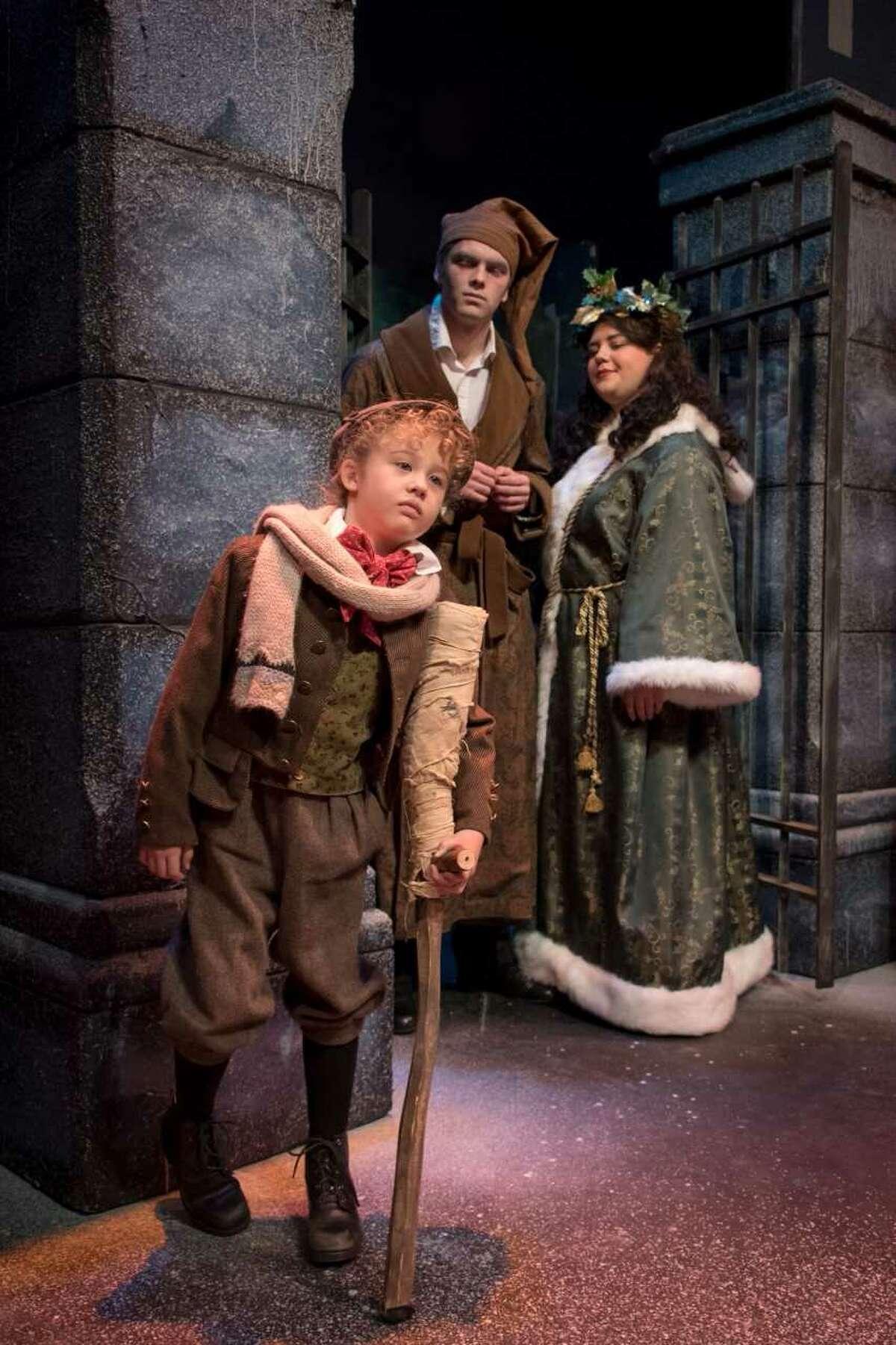 "KD McTeigue as Christmas Present, Charlotte Baecker as Tiny Tim and Lucas Phayre-Gonzalez as Scrooge in ""A Christmas Carol"" Photo credit: Tamara Hansen"