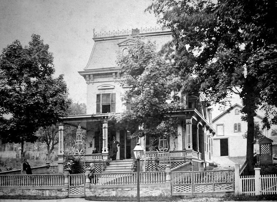 One of the many stately homes along the Village Green in New Milford that remains these days from the 18th and 19th centuries is the residence at 42 Main St, just north of the Richmond Citizen Center. Above, fashionably dressed men and women gather to be part of this 1890 photograph. The building now serves as the home to the Geron Nursing & Respite Care, Inc. If you have a photograph you'd like to share, contact Deborah Rose at drose@newstimes.com or 860-355-7324. Photo: Courtesy Of The New Milford Historical Society / The News-Times Contributed