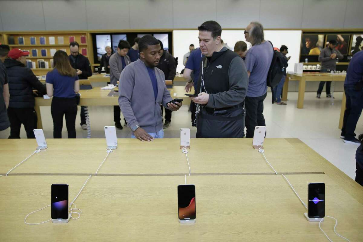 Customers look at the new iPhone X at the Apple Union Square store Friday, Nov. 3, 2017, in San Francisco. Apple ranked as the No. 2 smartphone seller globally in the third quarter of 2017, according to Gartner.