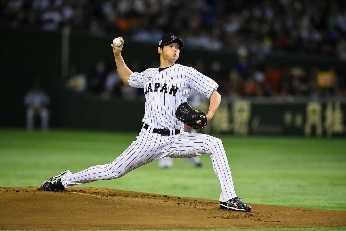 TOKYO, JAPAN - NOVEMBER 19: Starting pitcher Shohei Otani #16 of Japan throws in the top of first inning during the WBSC Premier 12 semi final match between South Korea and Japan at the Tokyo Dome on November 19, 2015 in Tokyo, Japan. (Photo by Masterpress/Getty Images)