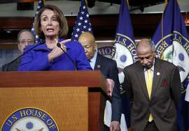 "FILE -- In this file photo from Tuesday, Feb. 14, 2017, House Minority Leader Nancy Pelosi, D-Calif., Rep. John Conyers, D-Mich., right, and other top House Democrats, at a news conference on Capitol Hill in Washington.  Pelosi said today, Thursday, Nov. 30, 2017, that Conyers should resign, saying the accusations are ""very credible.""  (AP Photo/J. Scott Applewhite, file)"