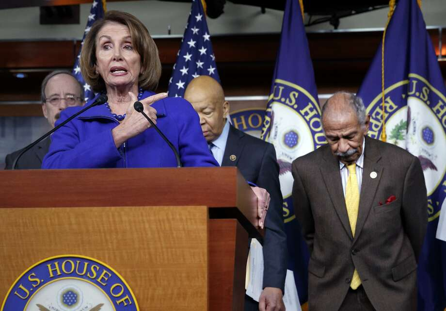 """FILE -- In this file photo from Tuesday, Feb. 14, 2017, House Minority Leader Nancy Pelosi, D-Calif., Rep. John Conyers, D-Mich., right, and other top House Democrats, at a news conference on Capitol Hill in Washington.  Pelosi said today, Thursday, Nov. 30, 2017, that Conyers should resign, saying the accusations are """"very credible.""""  (AP Photo/J. Scott Applewhite, file) Photo: J. Scott Applewhite, Associated Press"""