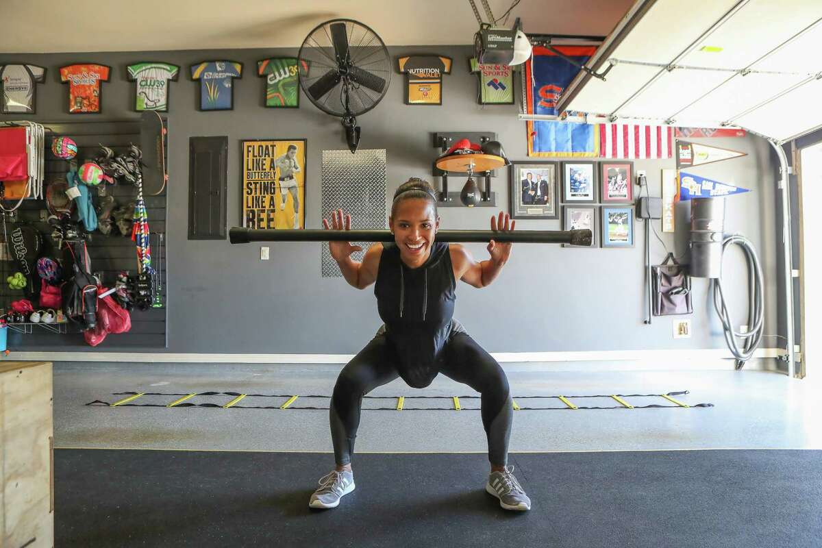 KHOU 11 Anchor Mia Gradney decided to turn her garage into a gym is photographed Tuesday, Nov. 28, 2017, in Fort Bend County. She has a weight bench, a spin bike and other equipment and says you don't need a lot of money to have a home gym. ( Steve Gonzales / Houston Chronicle )