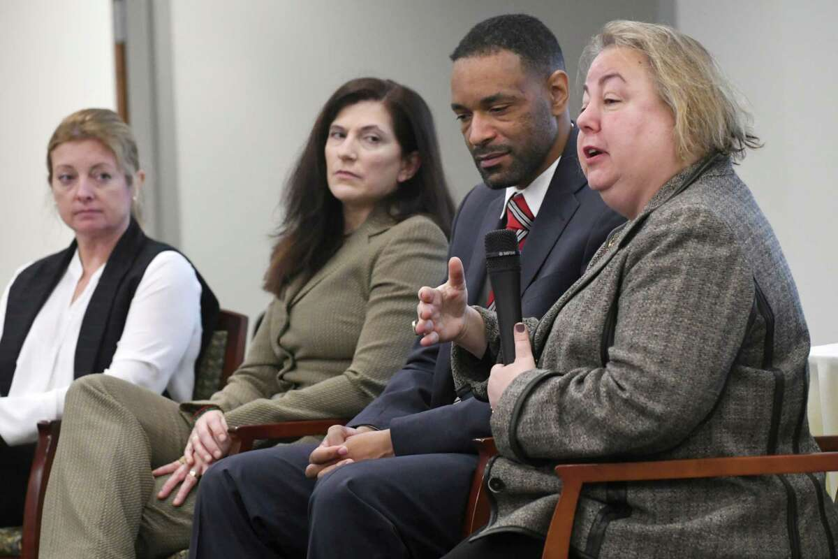 New York State Senator Liz Krueger, right, ranking democrat on the Finance Committee, speaks during a panel discussion on the gig economy, cyber threats and the Capital Region's workforce at an event at Hearst Media Center on Thursday, Nov. 30, 2017 in Colonie, N.Y. The other panelist are from left, Heather Briccetti, president and CEO of the Business Council of New York State, Janet Carmosky, co-founder and executive director of Albany CanCode, Antony Haynes, associate dean for Strategic Initiatives and Information Systems, director of Cybersecurity and Privacy Law, and Assistant Professor of Law at the Albany Law School (Lori Van Buren / Times Union)