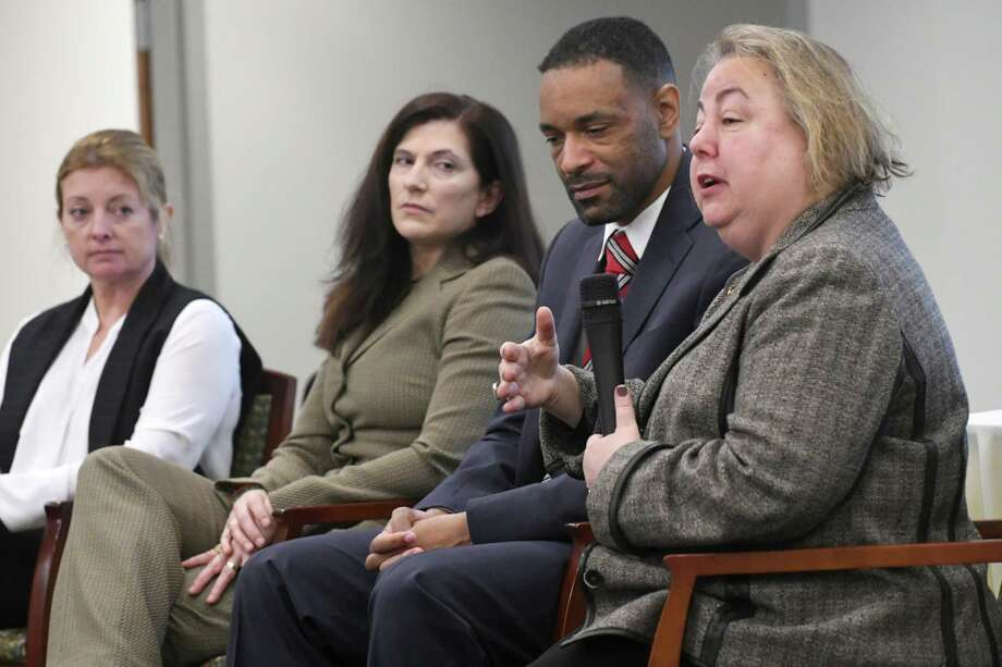 New York State Senator Liz Krueger, right, ranking democrat on the Finance Committee, speaks during a panel discussion on the gig economy, cyber threats and the Capital Region's workforce at an event at Hearst Media Center on Thursday, Nov. 30, 2017 in Colonie, N.Y. The other panelist are from left, Heather Briccetti, president and CEO of the Business Council of New York State,  Janet Carmosky, co-founder and executive director of Albany CanCode, Antony Haynes, associate dean for Strategic Initiatives and Information Systems, director of Cybersecurity and Privacy Law, and Assistant Professor of Law at the Albany Law School (Lori Van Buren / Times Union) Photo: Lori Van Buren, Albany Times Union / 20042272A