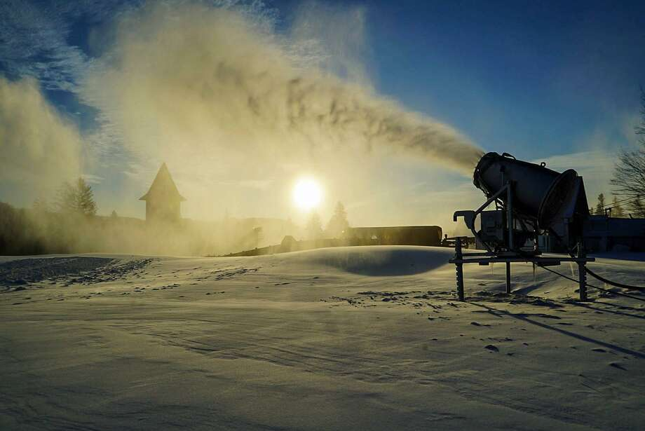 One of Mount Snow's 250 fan gun blows show at the base of the southern Vermont resort. Mount Snow will be offering online $12 lift tickets for Tuesday, Dec. 12, 2017. On Sunday, Dec. 3, 2017 Okemo Mountain Resort, also in Vermont, will offer $39 tickets with the donation of at least five non-perishable food items, a new/unused child's toy, new/unused clothing item, or $20 cash. Photo: Mount Snow Photo
