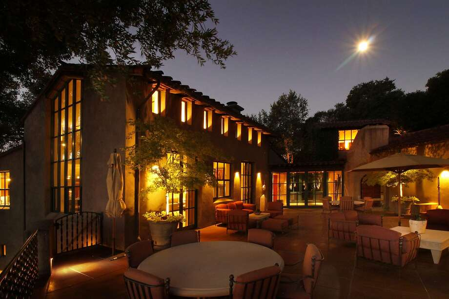 The patio off the living room, as seen at dusk. Photo: Jack Journey