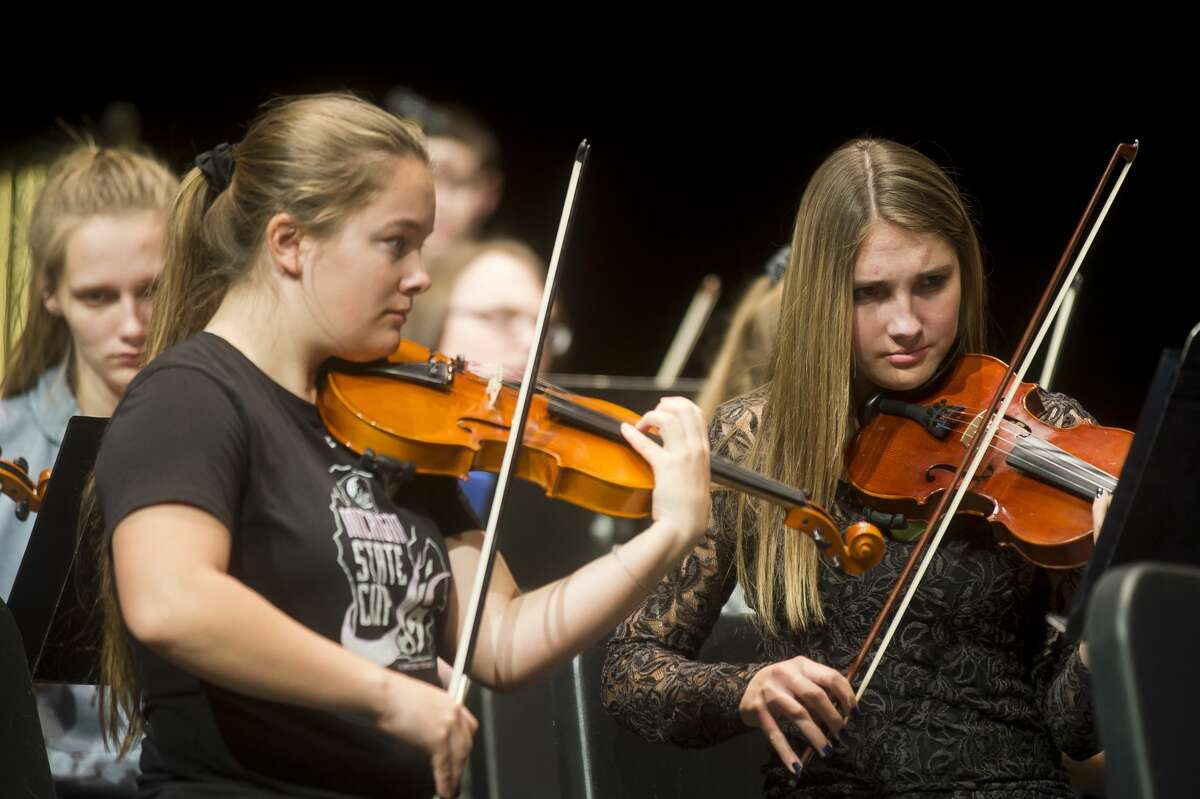 Members of the Midland High School orchestra perform during a dress rehearsal on Tuesday, Nov. 28, 2017 for the annual Rhapsody Rendezvous talent show. Two shows will be held on Saturday, at 1:30 and 7:30 p.m. at the Midland Center for the Arts. Tickets are $15 for adults and $7 for students. (Katy Kildee/kkildee@mdn.net)