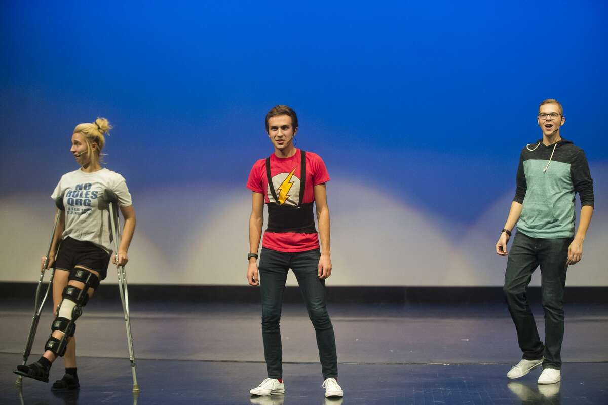 From left, Gloria Heye, Drew Spencer and Josh Danielson perform during a dress rehearsal on Tuesday, Nov. 28, 2017 for the annual Rhapsody Rendezvous talent show. The three students, along with Maddy Arnold, will emcee the show. Two shows will be held on Saturday, at 1:30 and 7:30 p.m. at the Midland Center for the Arts. Tickets are $15 for adults and $7 for students. (Katy Kildee/kkildee@mdn.net)