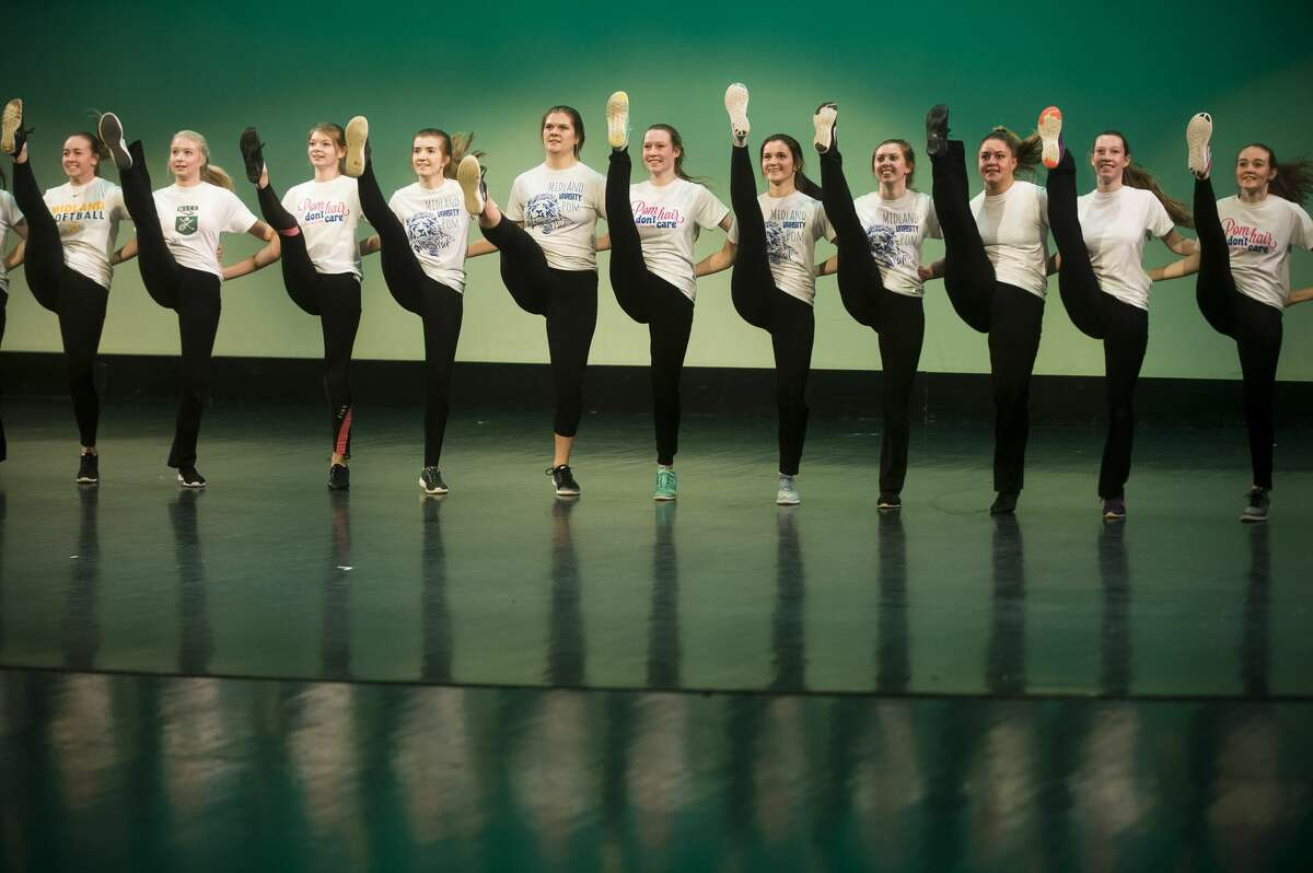 Members of the Midland High School varsity pom squad perform during a dress rehearsal on Tuesday, Nov. 28, 2017 for the annual Rhapsody Rendezvous talent show. Two shows will be held on Saturday, at 1:30 and 7:30 p.m. at the Midland Center for the Arts. Tickets are $15 for adults and $7 for students. (Katy Kildee/kkildee@mdn.net)