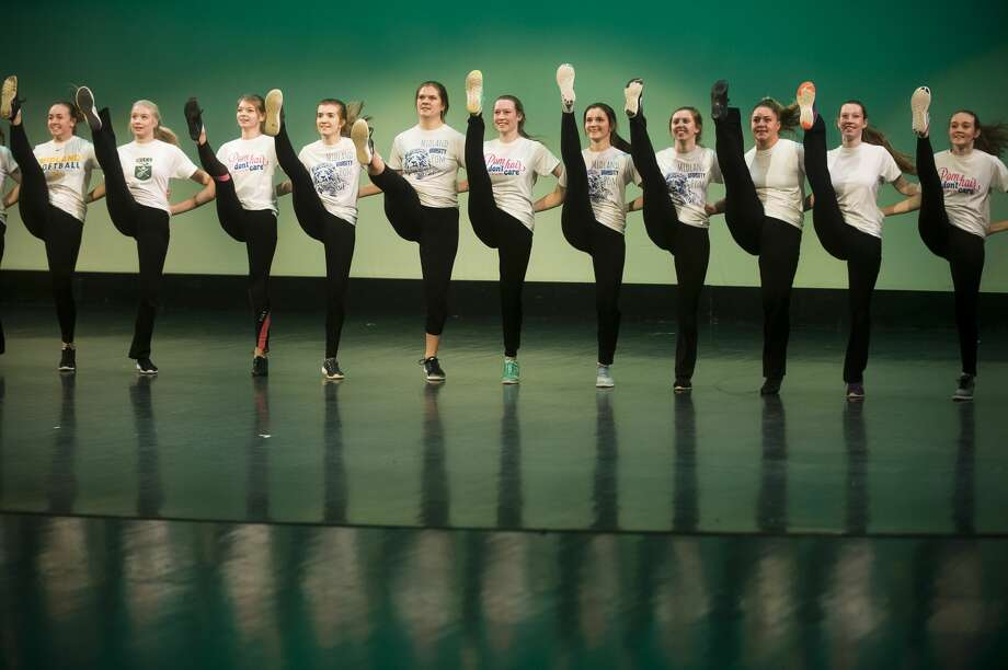 Members of the Midland High School varsity pom squad perform during a dress rehearsal on Tuesday, Nov. 28, 2017 for the annual Rhapsody Rendezvous talent show. Two shows will be held on Saturday, at 1:30 and 7:30 p.m. at the Midland Center for the Arts. Tickets are $15 for adults and $7 for students. (Katy Kildee/kkildee@mdn.net) Photo: (Katy Kildee/kkildee@mdn.net)