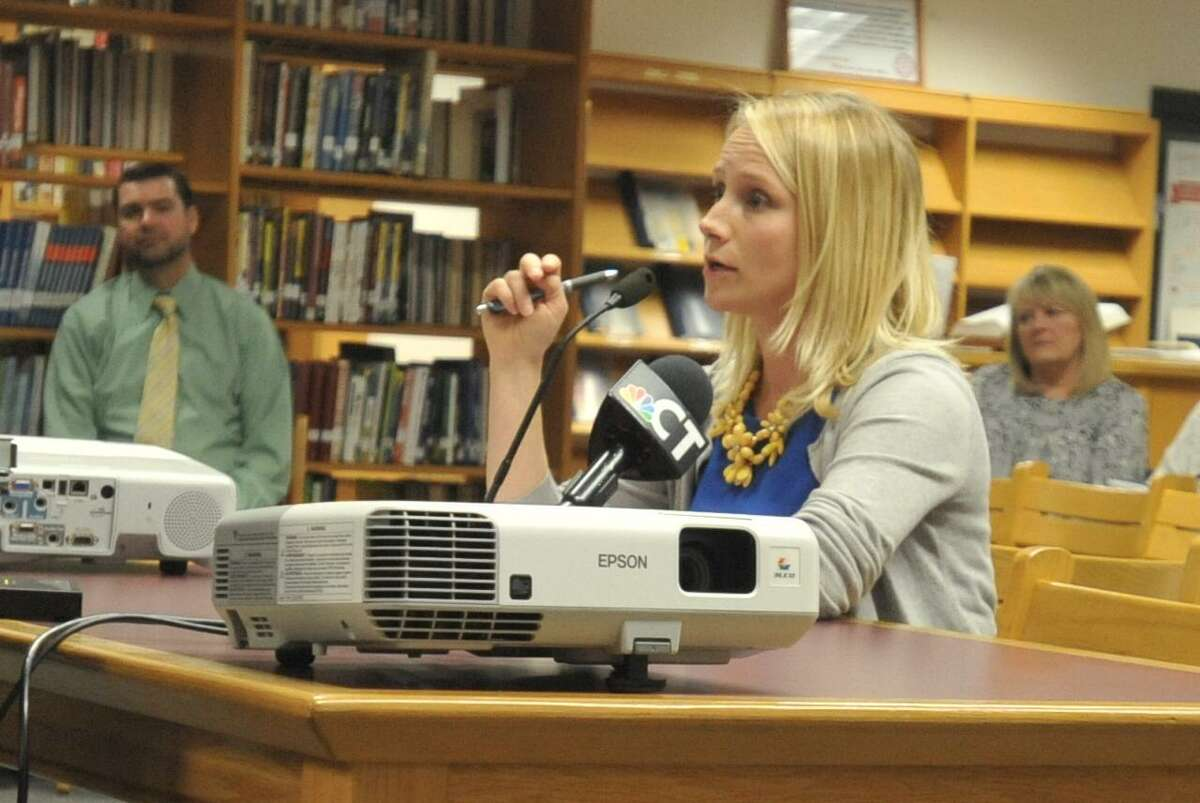 The Torrington Board of Education voted to close East School Wednesday, paving the way for the redistricting of city elementary schools. Board members will be tasked with deciding whether to renovate or permanently close the building in the future. Above, parent Keri Hoehne speaks to the board.