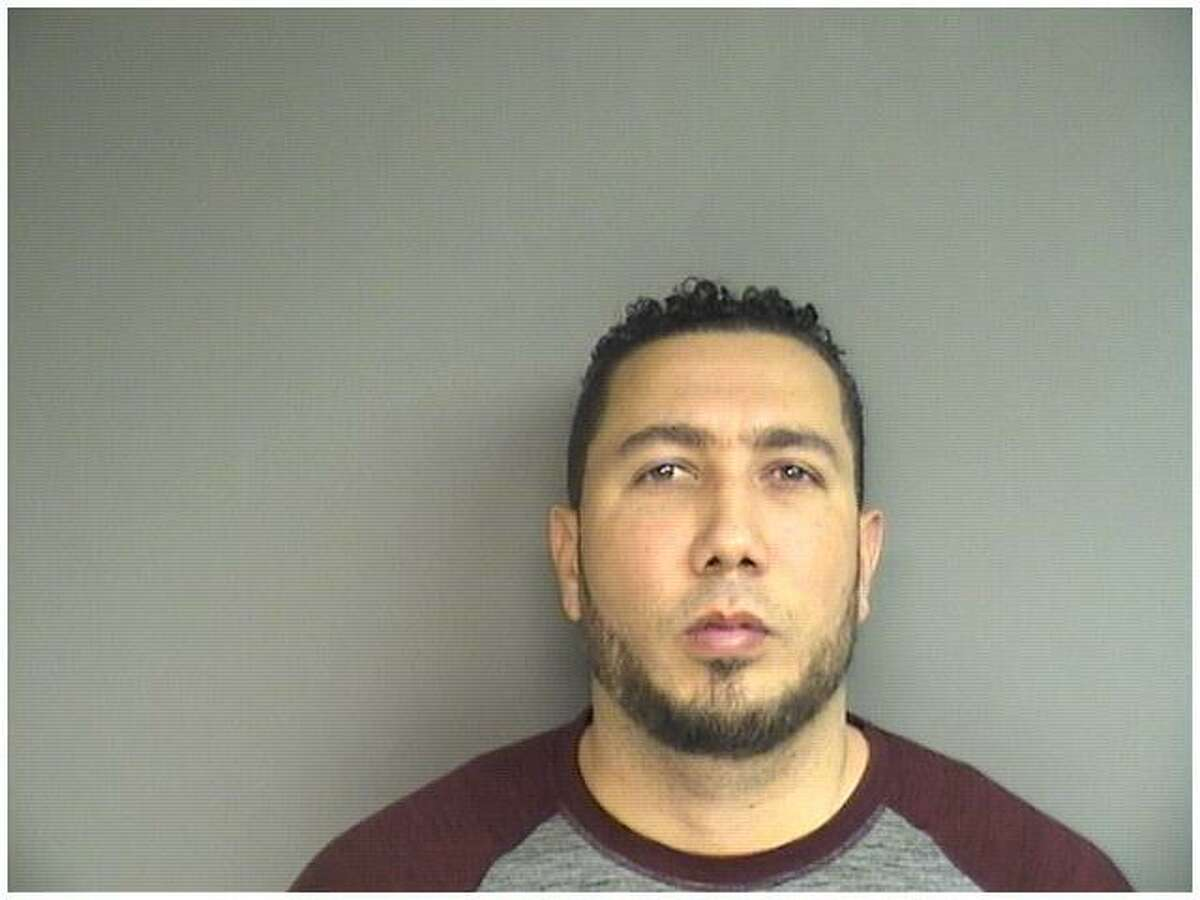 Alexis Velox, 38, of Stamford, was charged with taking too long to report that his gun had been stolen and leaving the loaded weapon in his unlocked car parked on a West Side street.