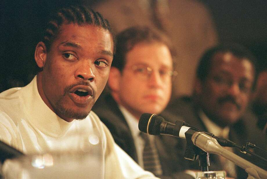THEN: The figure in the middle of it all, Latrell SprewellAfter choking coach P.J. Carlesimo, Sprewell was immediately suspended 10 games. As the story of the incident went public, though, Sprewell's punishment ballooned. The Warriors terminated his contract and the league handed him a year-long suspension. Here, Sprewell apologizes during a press conference with his agent Arn Tellem (center) and attorney Johnnie Cochran on Dec. 9, 1997. Photo: JOHN G. MABANGLO/AFP/Getty Images