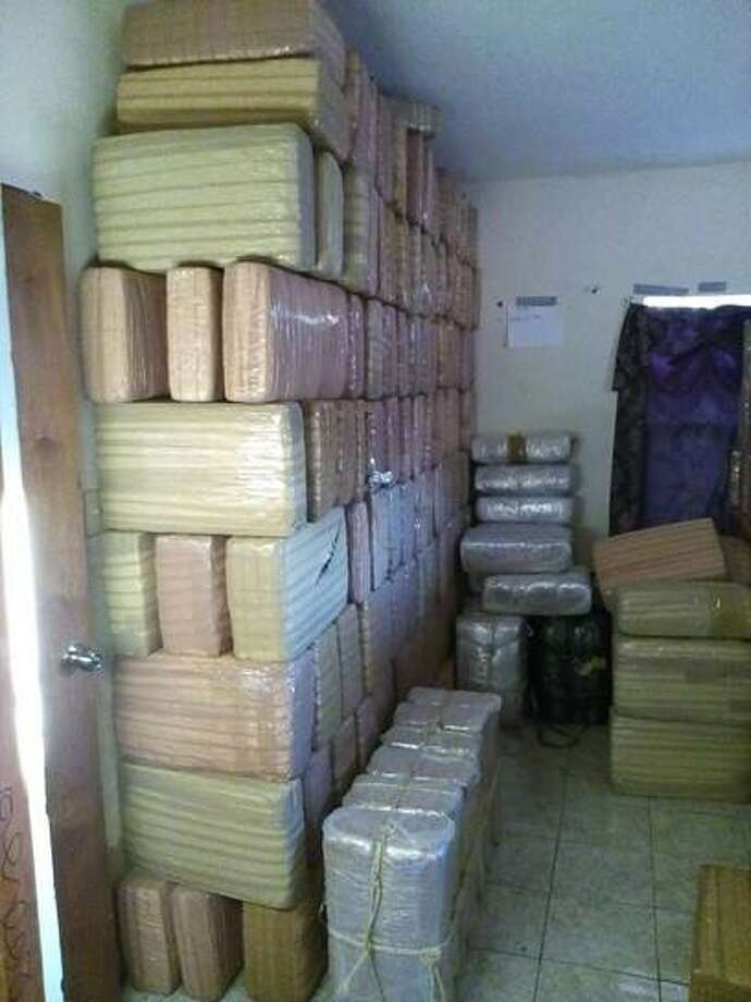 Tamaulipas State Police have seized 1,181 tape-wrapped packages of marijuana in the basement of a home in Camargo near the Texas border. Photo: Tamaulipas State Police