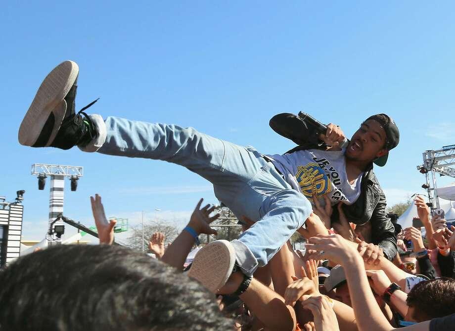 Rapper Vic Mensa, shown performing in 2014 in Austin, Texas, draws on his roots as a punk rocker and skater. Photo: Rachel Murray, Getty Images For MTV
