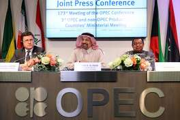 Alexander Novak, Russia's energy minister, left, and Mohammed Barkindo, secretary general of the Organization of Petroleum Exporting Countries (OPEC), right, look on as Khalid Al-Falih, Saudi Arabia's energy and industry minister, reacts during a news conference following the 173rd Organization of Petroleum Exporting Countries (OPEC) meeting in Vienna, Austria, on Thursday, Nov. 30, 2017. OPEC agreed to extend its oil-production cuts to the end of 2018 and included Libya and Nigeria in the deal for the first time, according to delegates gathered in Vienna. Photographer: Akos Stiller/Bloomberg