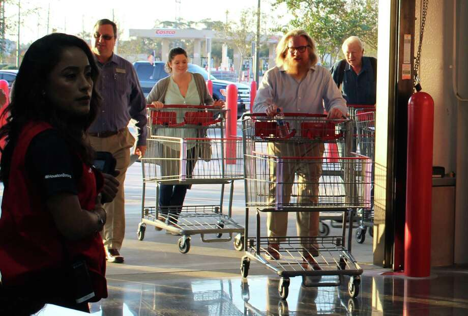 Shoppers enter Costco in Humble after a ribbon cutting ceremony on Thursday, Nov. 30, to celebrate the location's grand reopening following a 96-day restoration process due to flood damage from Hurricane Harvey. Photo: Melanie Feuk