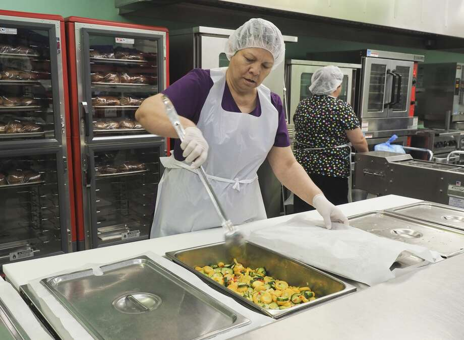 Cooking for Meals on Wheels is a labor of love for Lupe Sanchez. Her mother is one of the clients. Photo: Tim Fischer/Midland Reporter-Telegram