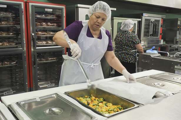 Cooking for Meals on Wheels is a labor of love for Lupe Sanchez. Her mother is one of the clients.