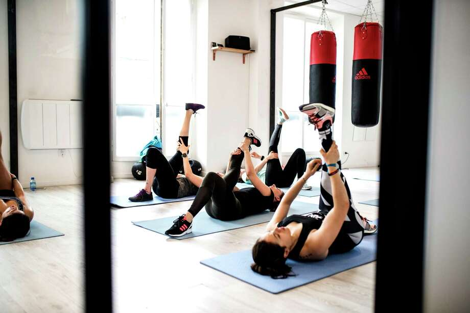 The workout studio-cafe hybrid Chez Simone holds that athleticism paired with avocado whole grain toasts with a side salad of chou kale, and maybe a detox cold press juice, is trés trendy. Photo: Edouard Nguyen. / Edouard Nguyen