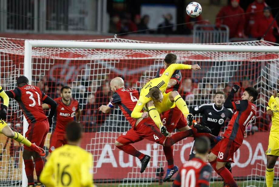 Columbus Crew's Adam Jahn battles for the ball with Toronto FC's Michael Bradley during the second half of an Eastern Conference MLS final playoff soccer game, Wednesday, Nov. 29, 2017 in Toronto. Photo: Mark Blinch /The Canadian Press