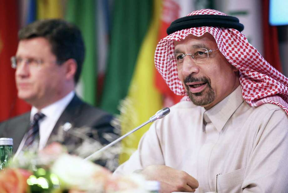 Alexander Novak, Russia's energy minister, left, looks on as Khalid Al-Falih, Saudi Arabia's energy and industry minister, speaks during a news conference after OPEC met in Vienna, Austria, on Thursday. The oil cartel and non-OPEC oil producing countries agreed to extend oil production cuts cuts of 1.8 million barrels a day through 2018. Photo: Akos Stiller /Bloomberg / © 2017 Bloomberg Finance LP