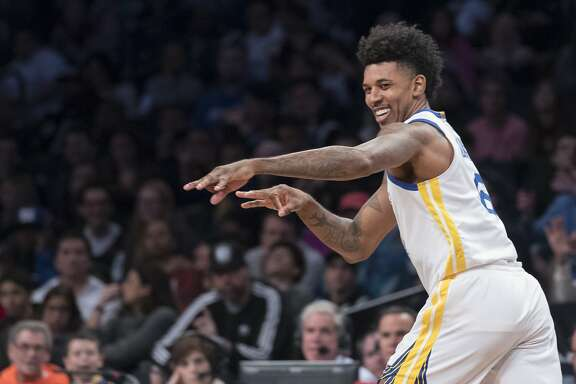 Golden State Warriors guard Nick Young gestures after scoring a 3-point goal during the first half of an NBA basketball game, Sunday, Nov. 19, 2017, in New York. (AP Photo/Mary Altaffer)