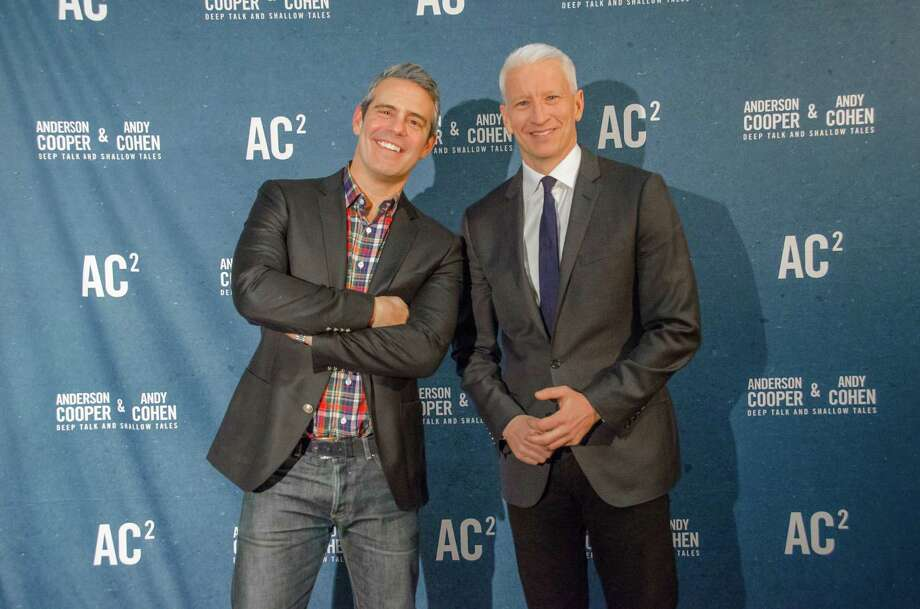 Andy Cohen, left, and Anderson Cooper say they have vivid memories of past visits to Houston. Photo: Glenn Kulbako