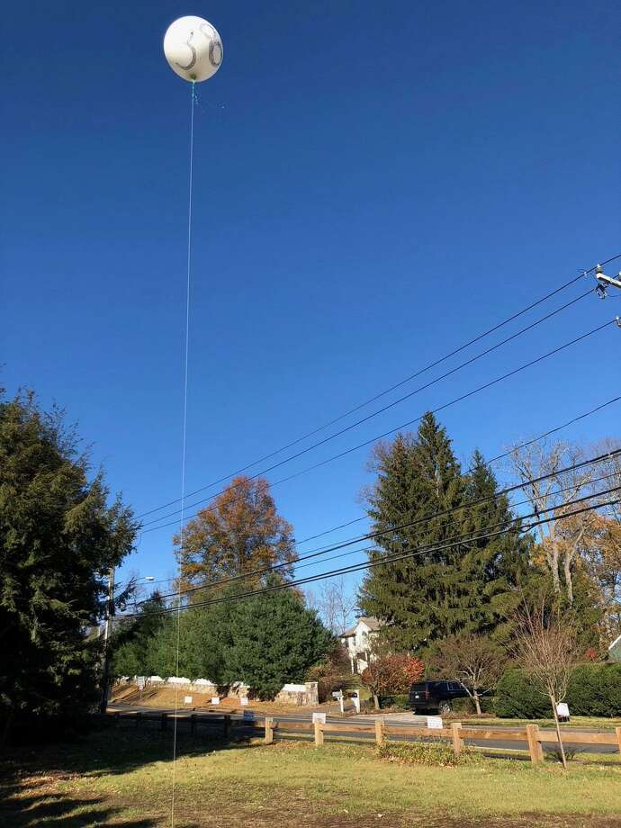 Residents flew a balloon on Thanksgiving Day to protest the approved construction of two Aquarion Water Company tanks on North Avenue. Photo: Contributed Photo