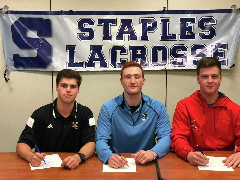 Staples boys lacrosse commits, left, Dobson Cooper, Evan Zinn, and Matt Garber signing their National Letters of Intent all to Division-I programs. Cooper will be playing at Vermont. Zinn is signed to Johns Hopkins. While Garber is slated to play for Boston University. Photo: Contributed Photo